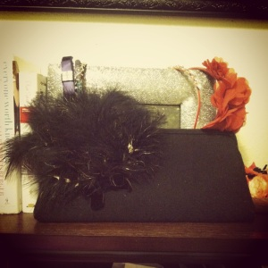 Vintage clutch with a handcrafted painted feather brooch and vintage black velvet bow detail